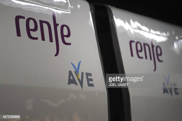 A Spanish stateowned Renfe railway AVE high speed train is pictured on December 15 2013 at Barcelona's train station during the inaugural trip of a...