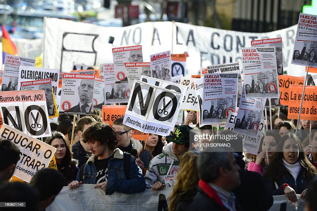 Spanish student brandish placards as they demonstrate against the law of Spanish Minister of Education, Culture and Sport Jose Ignacio Wert in Madrid on February 6, 2013.