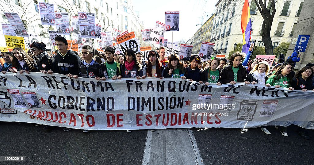 Spanish student hold banners and placards as they demonstrate against the law of Spanish Minister of Education, Culture and Sport Jose Ignacio Wert in Madrid on February 6, 2013.