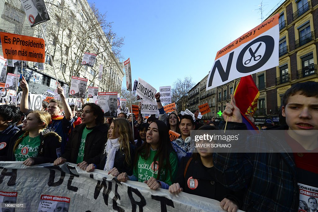 Spanish student shout and hold banners and placards as they demonstrate against the law of Spanish Minister of Education, Culture and Sport Jose Ignacio Wert in Madrid on February 6, 2013.