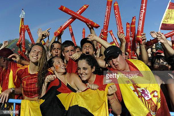 Spanish supporters celebrate as they wait for the arrival of Spain's team during a concert organised in Madrid on July 12 2010 a day after they won...