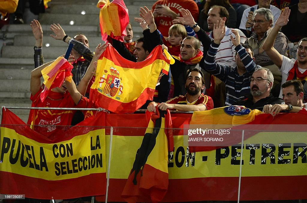Spanish supporters cheer their team during the 23rd Men's Handball World Championships preliminary round Group D match Spain vs Croatia at the Caja Magica in Madrid on January 19, 2013.