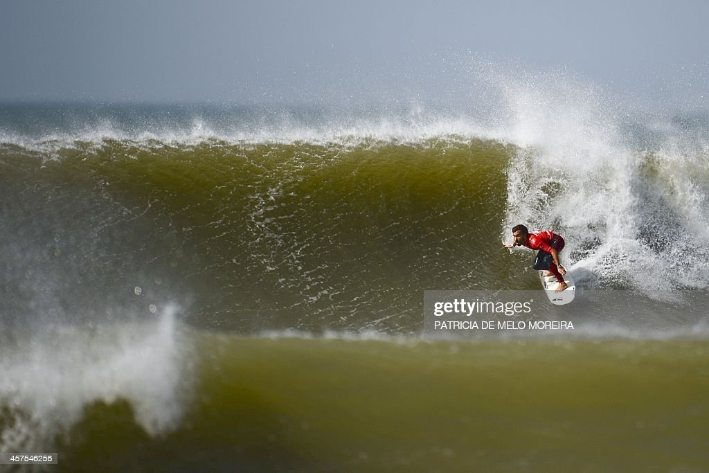 Spanish surfer Aritz Aranburu competes in the round 5 heat during the Moche Rip Curl Pro Portugal at Supertubos Beach in Peniche on October 20 2014...