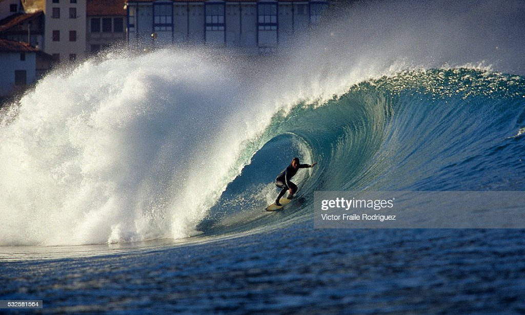 Spanish surfer Iker Acero rides a big wave in Mundaka one of Europe's most famous beach break waves Photo by Victor Fraile Image by © Victor Fraile