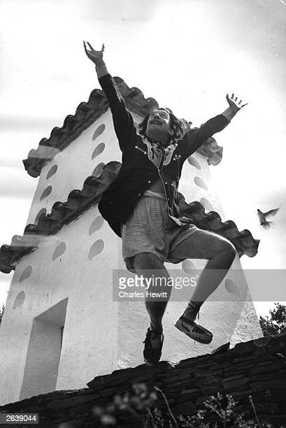 Spanish surrealist artist Salvador Dali cavorting on a rooftop at his home in Cadaques on the Spanish Costa Brava Original Publication Picture Post...