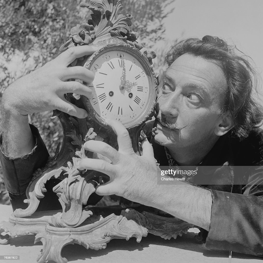 Spanish surrealist artist Salvador Dali clutches an ornate clock at his home in Cadaques on the Costa Brava Spain 8th January 1955 Original...