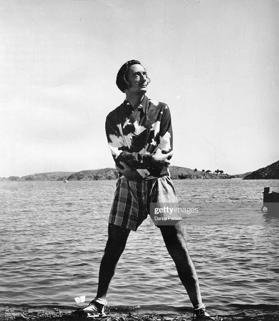 Spanish surrealist artist Salvador Dali on the beach outside his villa at Port Lligat near Cadaques on the Spanish coast Original Publication Picture...