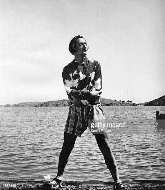 Spanish surrealist artist Salvador Dali on the beach outside his villa at Port Lligat near Cadaques on the Spanish coast Original Publication Picture...