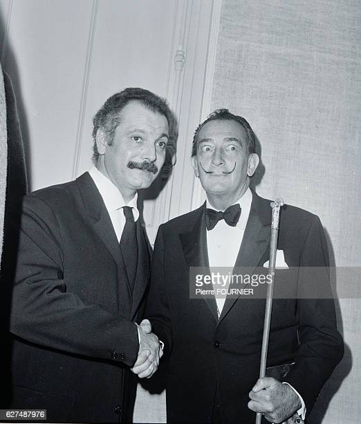 Spanish surrealist artistpainter sculptor and screenwriter Salvador Dali and French singer and songwriter Georges Brassens