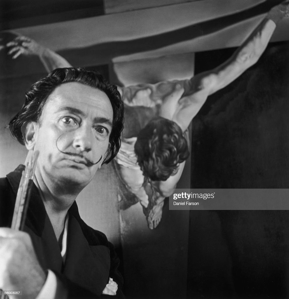 Spanish surrealist painter Salvador Dali (1904 - 1989) in his studio in Port Lligat with his painting entitled 'Christ of St John on the Cross', 17th November 1951. Original Publication: Picture Post - 5587 - We Visit Dali - pub. 1951.