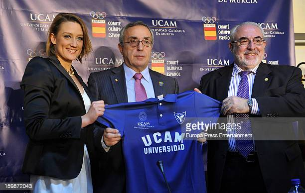 Spanish swimmer Mireia Belmonte poses with Alejandro Blanco and Jose Luis Mendoza during a press conference to announce that Mireia has signed an...