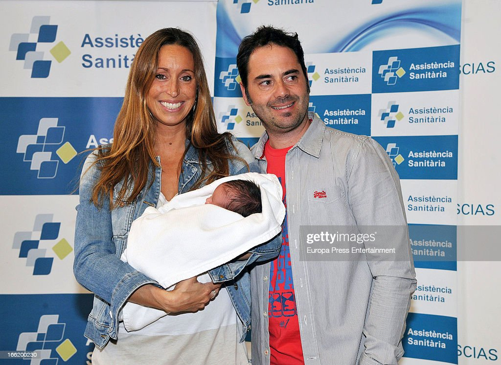 Spanish synchronized swimmer Gemma Mengual and her husband Enric Martin present their newborn child Joe on April 9, 2013 in Barcelona, Spain.