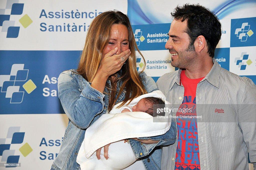 Spanish synchronized swimmer Gemma Mengual and her husband Enric Martin present their newborn child Joe on April 9, 2013 in Barcelona, Spain.