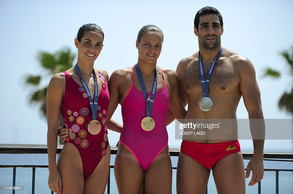Spanish synchronized swimmer Ona Carbonell Ballestero, Spanish waterpolo captain Jennifer Pareja and Spanish waterpolo player Marc Minguell Alferez pose with the silver, gold and bronze medals of the 15th FINA World Championships during their presentation in Barcelona on June 27, 2013. The 15th FINA World Championships will take place in Barcelona from July 19 to August 4, 2013.