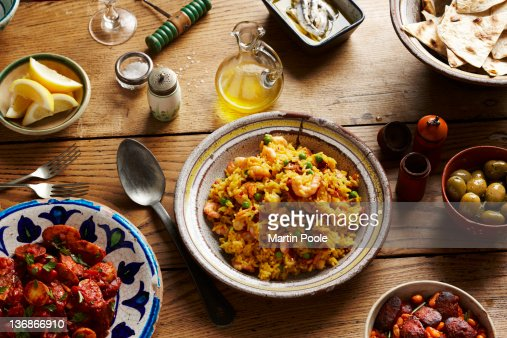 spanish tapas and paella on table