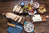 Spanish tapas, bar or street food. On wooden table in restaurant