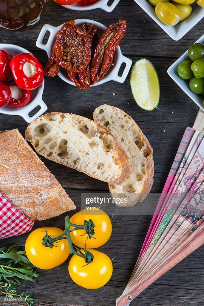 Spanish tapas on wooden rustic table from above : Stock Photo
