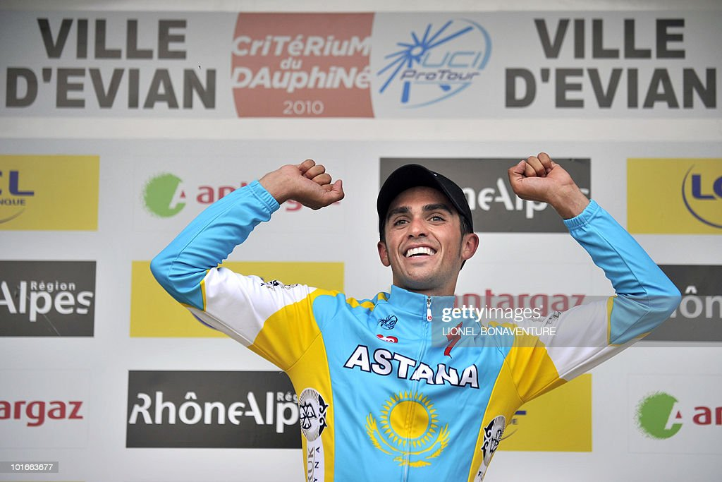 Spanish team leader Alberto Contador (Astana) celebrates on the podium on June 6, 2010 at the end of the 6,8 km individual time-trial and first stage of the 62th edition of the Criterium of Dauphine Libere cycling race run in Evian, eastern France. Contador won the first stage ahead of US Tejay Van Garderen (HTC-Columbia ) and Slovenian Janez Brajkovic (Radishack).