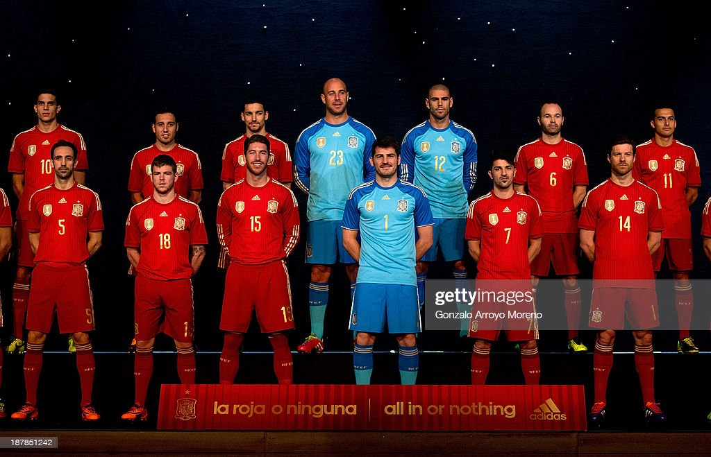 Spanish team pose for the Media during the Spanish Football Team Outfits Presentation at Compac Theatre on November 13, 2013 in Madrid, Spain.