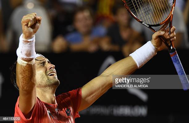 Spanish tennis player David Ferrer celebrates after winning his ATP Rio Open tournament final match against Italian Fabio Fognini in Rio de Janeiro...