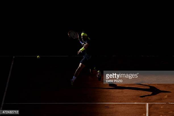 Spanish tennis player David Ferrer returns a ball to Spanish tennis player Fernando Verdasco during the Madrid Open tournament at the Caja Magica...