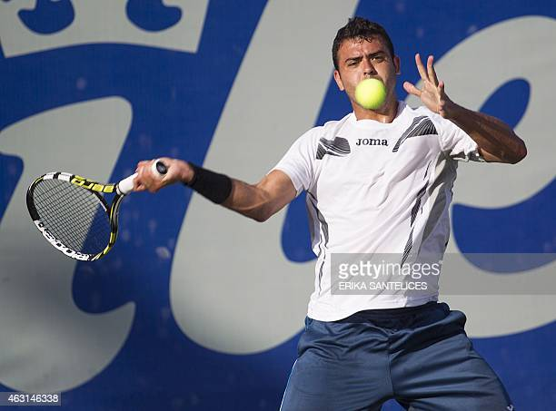 Spanish tennis player Inigo Cervantes returns the ball to Chilean Nicolas Jarry during their Milex Tennis Open match in Santo Domingo on February 10...