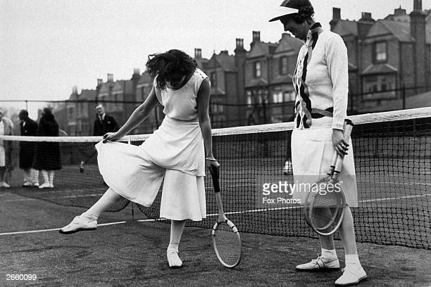 Spanish tennis player Lili de Alvarez shows off her divided skirt at the North London Tennis Tournament in Highbury London