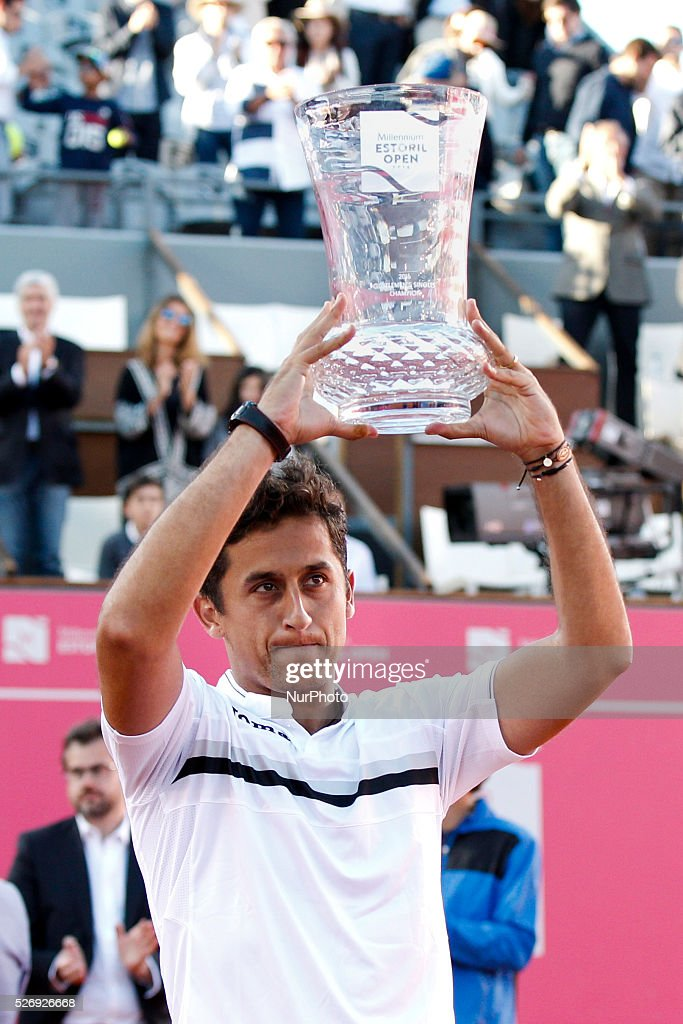 Spanish tennis player Nicolas Almagro lifts up his trophy during an award ceremony after winning the Portugal Open tennis tournament in Estoril, near Lisbon. Estoril on May 1, 2016.