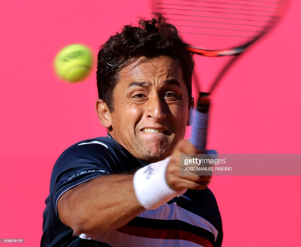 Spanish tennis player Nicolas Almagro returns a ball to Australian player Nick Kyrgios at the end of their semi-final match of the Estoril Open Tennis tournament in Estoril on April 30, 2016. / AFP / JOSE