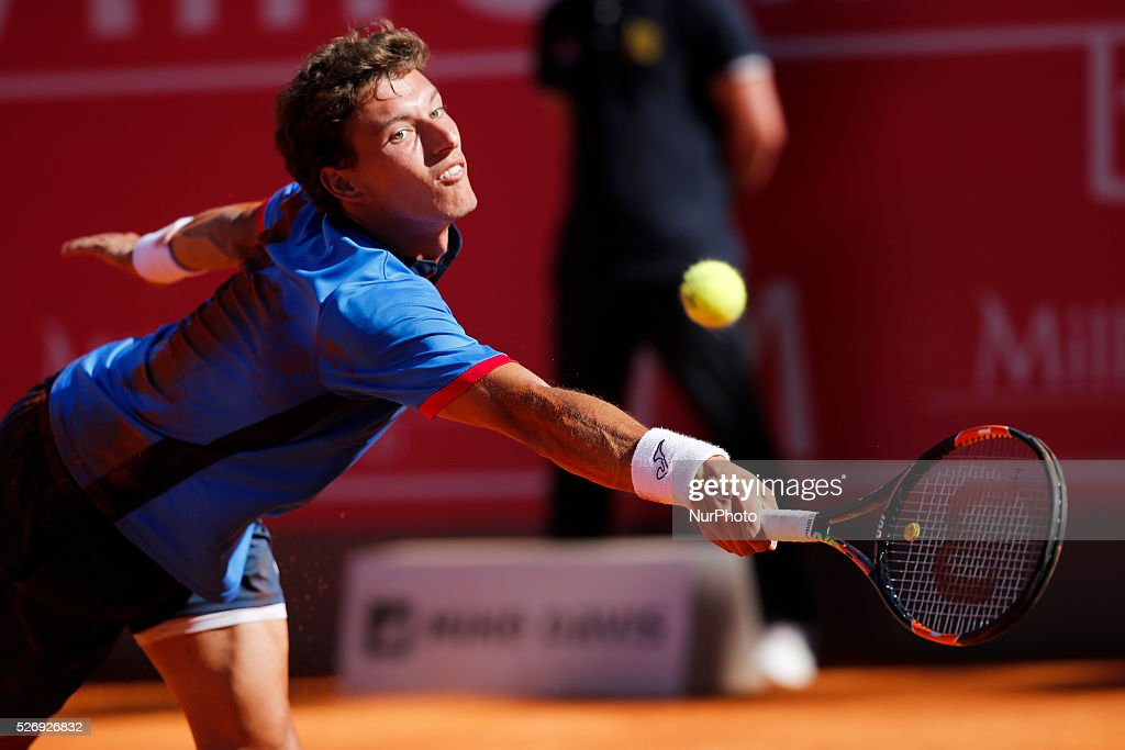 Spanish tennis player Pablo Carreno Busta returns a ball to Spanish tennis player Nicolas Almagro during their Millennium Estoril Open ATP Singles final tennis match, in Estoril, near Lisbon. Estoril on May 1, 2016.