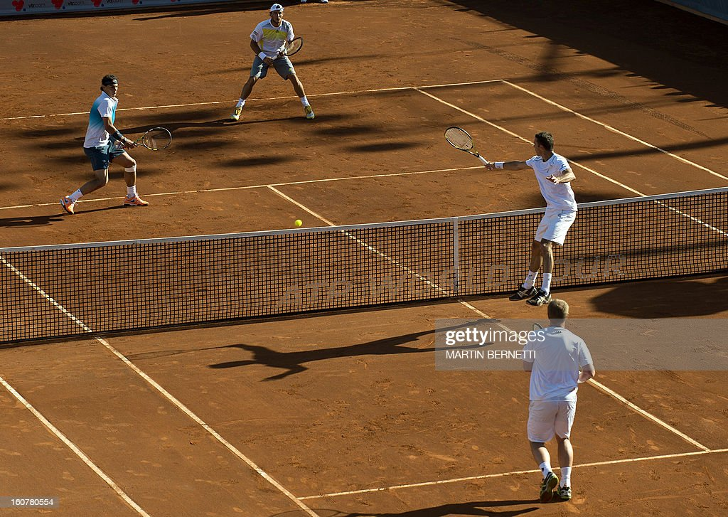 Spanish tennis player Rafael Nadal (top L) and Argentine Juan Monaco (2nd L) play against Czech Republic's Frantisek Cermank (down-L) and Lukas Dlouhy (down-R) during the Vina del Mar ATP tournament doubles match, in Vina del Mar, about 120 km northwest of Santiago, on February 5 , 2013.