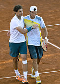 Spanish tennis player Rafael Nadal and Argentine Juan Monaco celebrate their victory against French Guillaume Rufin and Italian Filippo Volandri in...