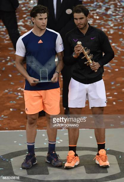 Spanish tennis player Rafael Nadal and Austrian tennis player Dominic Thiem pose with their trophies at the end of their ATP Madrid Open final match...