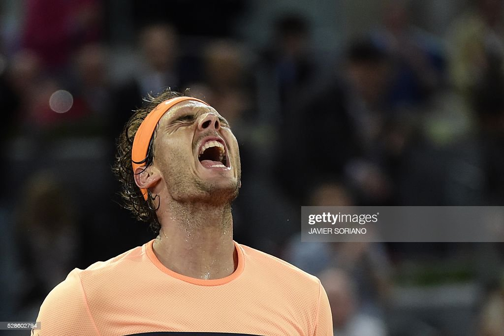 Spanish tennis player Rafael Nadal celebrates after wining his match against Portuguese tennis player Joao Sousa during the Madrid Open tournament at the Caja Magica (Magic Box) sports complex in Madrid on May 6, 2016. / AFP / JAVIER