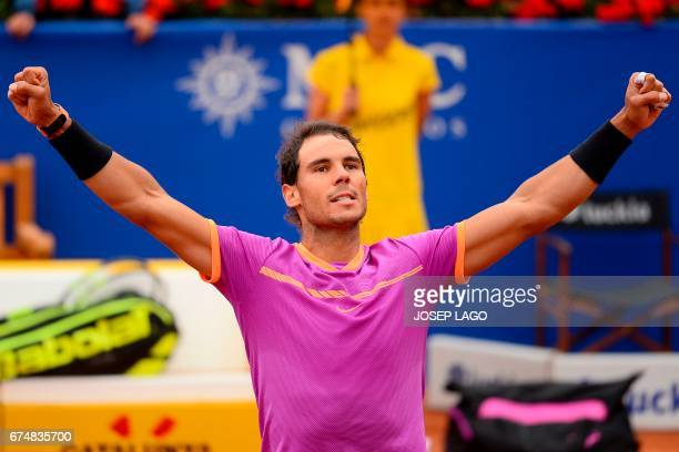 TOPSHOT Spanish tennis player Rafael Nadal celebrates his 63 64 victory over Argentinian tennis player Horacio Zeballos during the ATP Barcelona Open...