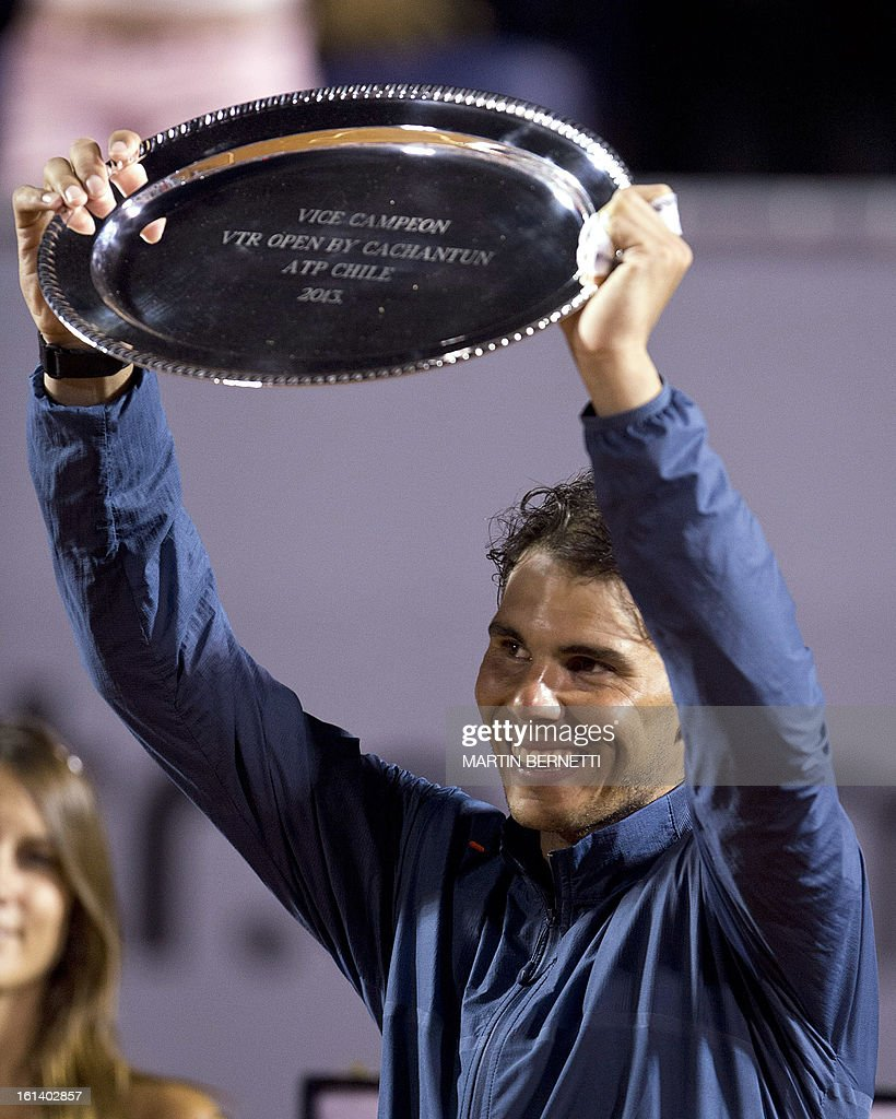 Spanish tennis player Rafael Nadal celebrates his second place position after losing his ATP Vina del Mar tournament final singles match against Argentine Horacio Zeballos in Vina del Mar, about 120 km northwest of Santiago, on February 10, 2013.