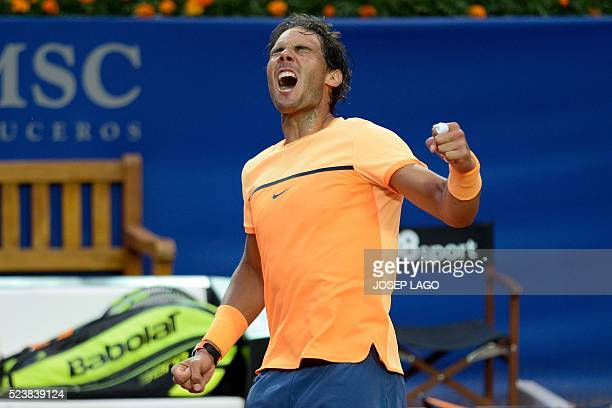 Spanish tennis player Rafael Nadal celebrates his victory over Japanese tennis player Kei Nishikori at the end of the final match of the ATP...