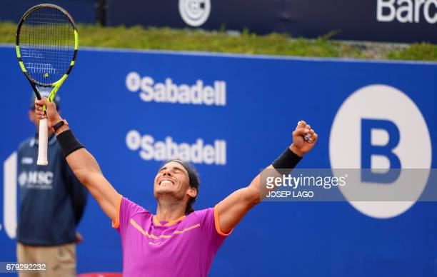Spanish tennis player Rafael Nadal celebrates his victory over Austrian tennis player Dominic Thiem at the end of the ATP Barcelona Open 'Conde de...