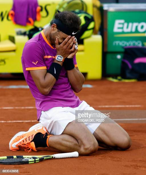 TOPSHOT Spanish tennis player Rafael Nadal celebrates his victory over Austrian tennis player Dominic Thiem at the end of their ATP Madrid Open final...