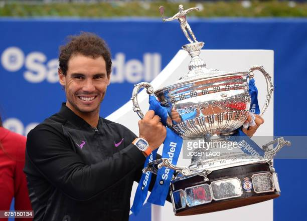 Spanish tennis player Rafael Nadal celebrates with his trophy after winning Austrian tennis player Dominic Thiem at the end of the ATP Barcelona Open...
