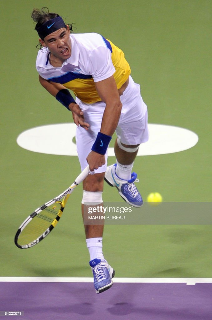 Spanish tennis player Rafael Nadal hits a return to France's Gael Monfils during their match in the 2009 Qatar Open in Doha on January 8 2009 Monfils...