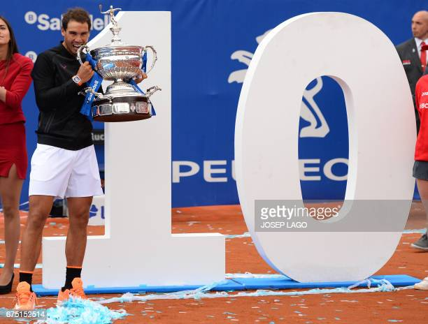 Spanish tennis player Rafael Nadal poses with his trophy as he celebrates after winning Austrian tennis player Dominic Thiem at the end of the ATP...