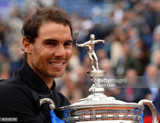 TOPSHOT Spanish tennis player Rafael Nadal poses with his trophy as he celebrates after winning Austrian tennis player Dominic Thiem at the end of...