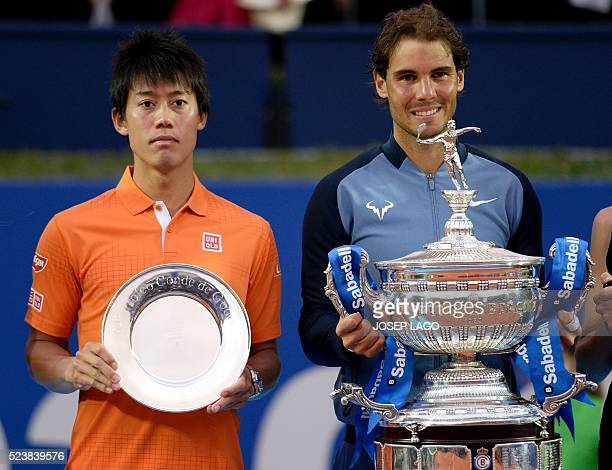 Spanish tennis player Rafael Nadal poses with his trophy next to Japanese player Kei Nishikori after the final match of the ATP Barcelona Open 'Conde...