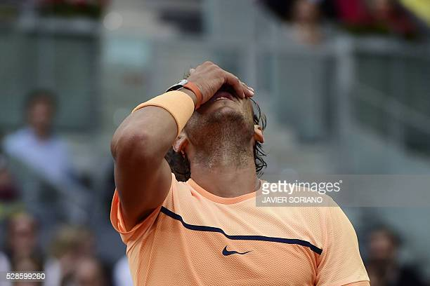 Spanish tennis player Rafael Nadal reacts after loosing a point against Portuguese tennis player Joao Sousa during the Madrid Open tournament at the...