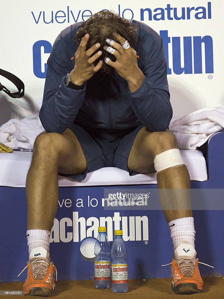 Spanish tennis player Rafael Nadal reacts after losing his ATP Vina del Mar tournament final singles match against Argentine Horacio Zeballos in Vina del Mar, about 120 km northwest of Santiago, on February 10, 2013.