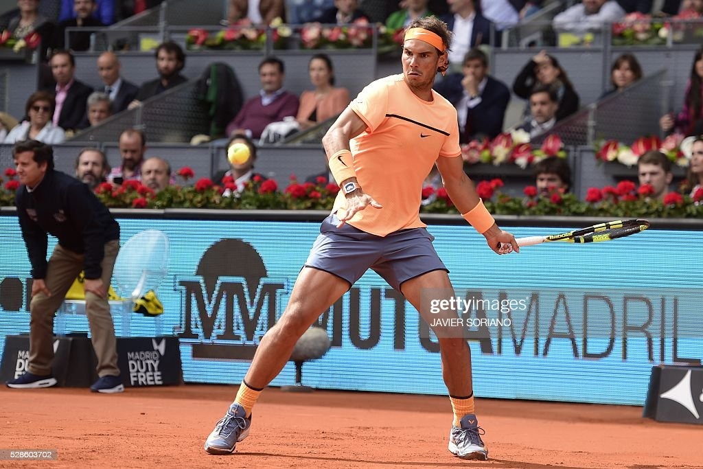 Spanish tennis player Rafael nadal returns a ball to Portuguese tennis player Joao Sousa during the Madrid Open tournament at the Caja Magica (Magic Box) sports complex in Madrid on May 6, 2016. Rafael Nadal will face defending champion Andy Murray in the Madrid Masters semi-finals after extending his perfect start to the European clay-court season to 13 matches with a 6-0, 4-6, 6-3 win over Joao Sousa today. SORIANO