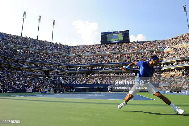Spanish tennis player Rafael Nadal returns a shot to Serbia's Novak Djokovic during their Men's US Open 2011 finals match at the USTA Billie Jean...
