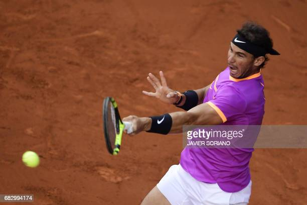 Spanish tennis player Rafael Nadal returns the ball to Austrian tennis player Dominic Thiem during their ATP Madrid Open final match in Madrid on May...