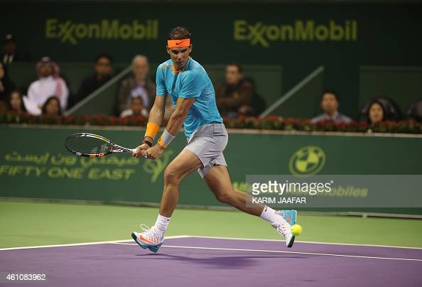 Spanish tennis player Rafael Nadal returns the ball to Michael Berrer of Germany during their tennis match in Qatar's ExxonMobil Open on January 6 in...